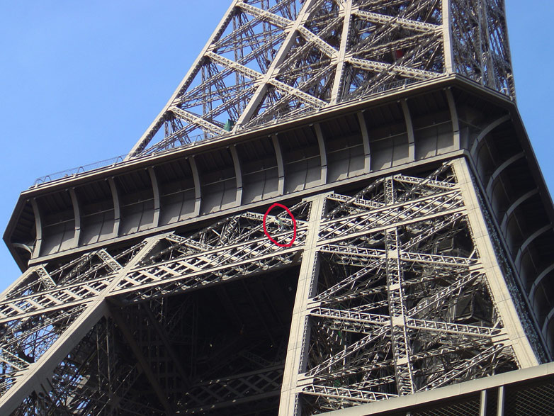 Mike Robertson climbing the Eiffel tower as a protest against the Burma Regime