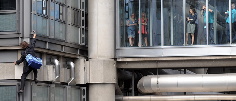 Mike Robertson scales the Lloyds building in London as a protest against the financial interests that Lloyds holds with the  Burma Regime.